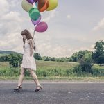 walking on road with balloons