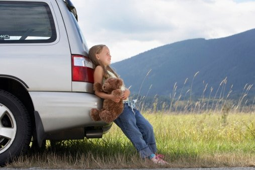 girl leaning on car