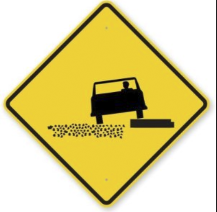 soft shoulder yellow road sign