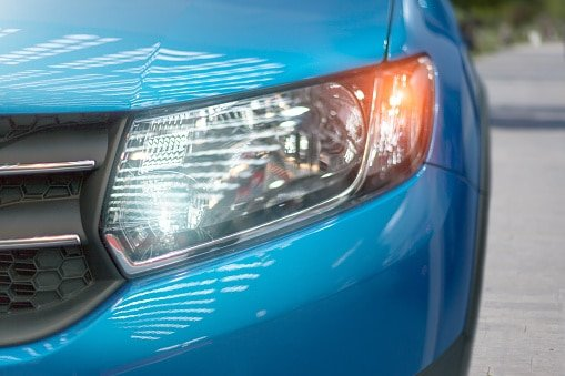 Blue modern car closeup of headlight